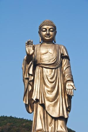 Oriental Buddha Statue, against Peaceful sky Stock Photo - 12157196