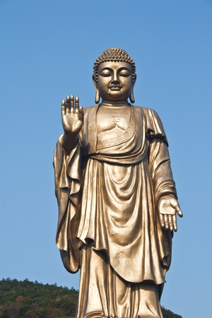 Oriental Buddha Statue, against Peaceful sky Stock Photo - 12157196