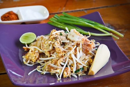 Thai noodle food  Pad thai  with vegetable and lime photo