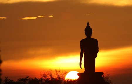 Silhouette of buddha statue in Bangkok, Thailand photo