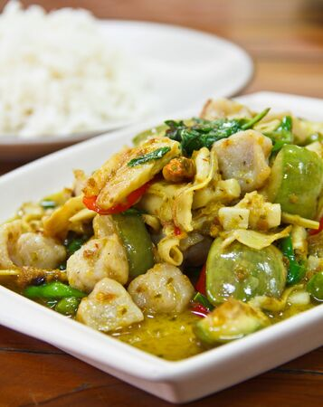 Green Curry on white plate with rice photo