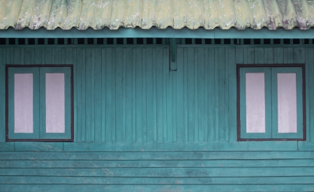two window on blue wood wall photo