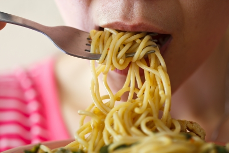 Beautiful young women are eating spaghetti in spicy Stock Photo - 14814012