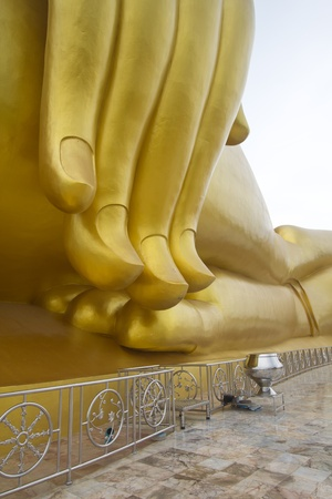 Big golden Buddha statue located in Thailand photo