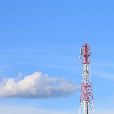 Red and white roof top cellular tower under blue sky Stock Photo - 16812679