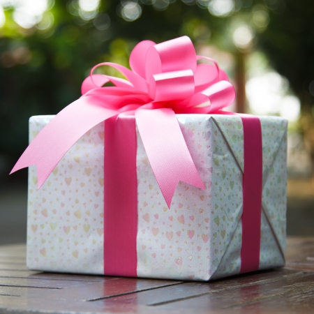 Images of pink gift boxes located on the table Stock Photo