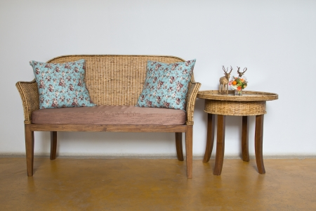 Wicker chairs are placed in the living room.