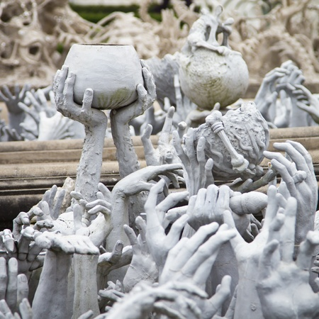 Series of Hands From Hell at Wat Rong Khun in Chiang Rai; Thailand photo