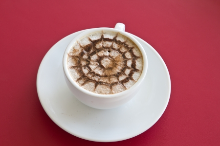 Make coffee latte with cream on red background photo