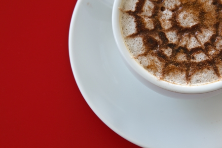 capucinno: Make coffee latte with cream on red background