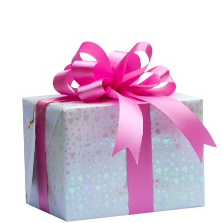 White gift box with pink ribbon bow, isolated on white photo
