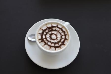 cappuccio: Make coffee latte with cream on black table