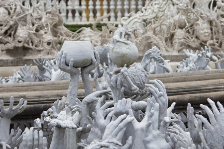 in low spirits: Series of Hands From Hell at Wat Rong Khun in Chiang Rai; Thailand