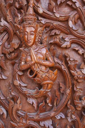 Traditional Thai style on temple door in Thailand photo