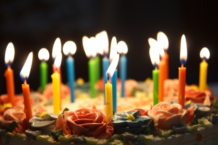 Many candels in birthday cake photo