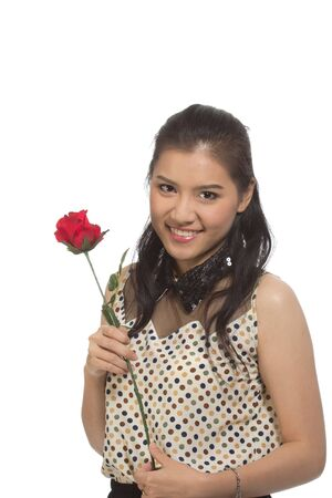 Close-up of a young woman with red flower Stock Photo - 17882762