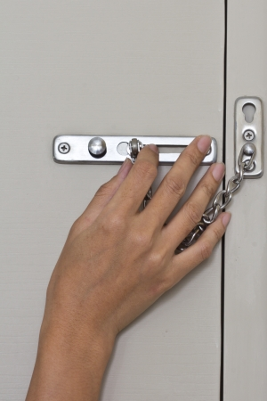 locking up: Locking up or unlocking door with hinge in hand