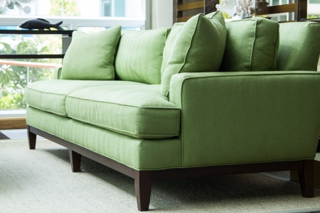 nice green sofa with pillows Stock Photo