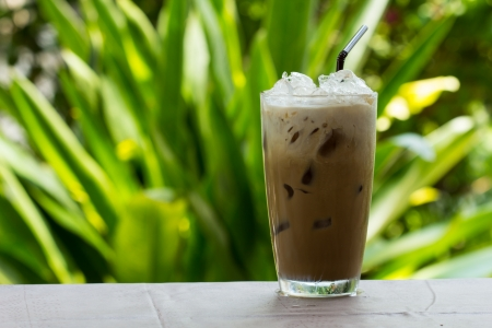 iced: Iced coffee with milk is on the table. Stock Photo
