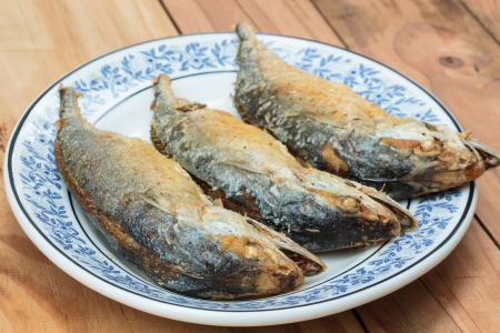 stuffed fish: Fried fish in the plate look appetizing.