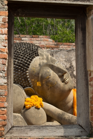 Buddha statue with window frame photo