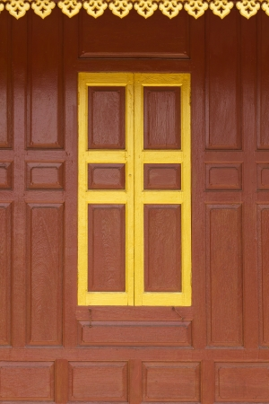 Traditional Thai style red door and window. photo