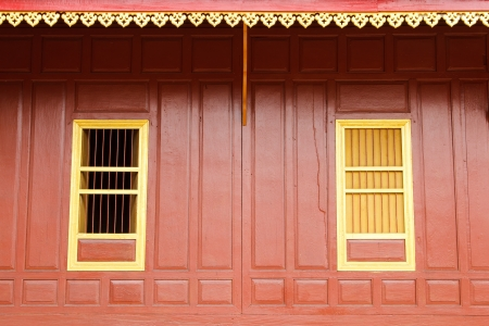 Traditional Thai style red door and window. Stock Photo - 20144649