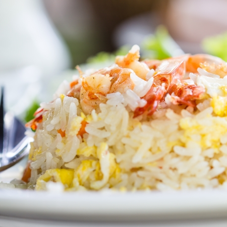 seafood dinner: fried rice with shrimp close up. Stock Photo