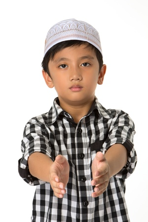 islamic pray: Islamic pray explanation. Asian child showing complete Muslim movements while praying