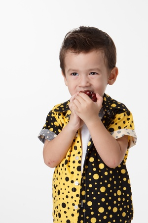 little boy with apple on a white background photo