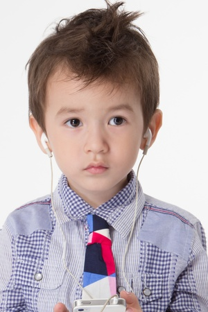 portrait of a nice boy with headphones photo