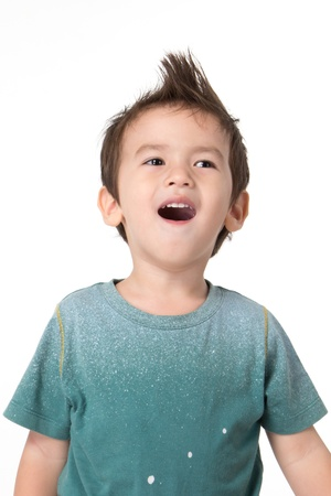 Portrait of happy little boy over white background photo