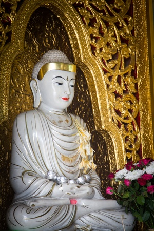 A smiling Buddha in the famous Shwedagon Pagoda, Yangon, Burma, Myanmar, Southeast Asia photo