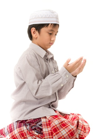 Islamic pray explanation. Asian child showing complete Muslim movements while praying. photo