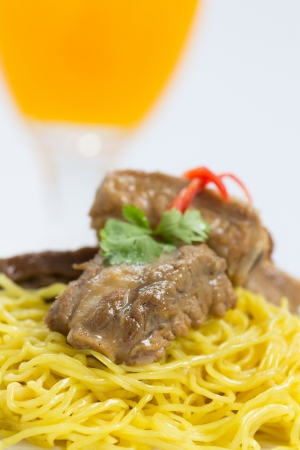 Asian style noodle with pork and vegetables photo