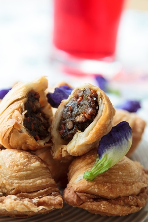 Pastry samosas in white dish appealing. photo