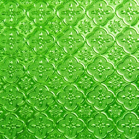Green of a beautiful stained glass in the background. photo
