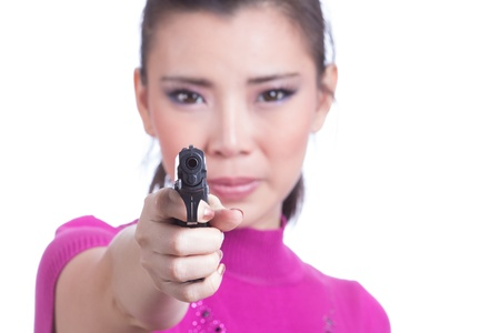 Beautiful young woman aiming a gun. photo