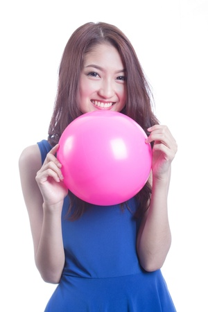 attractive asian woman playing with ball on white background photo