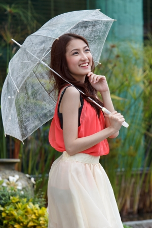 Portrait of beautiful female with umbrella Stock Photo