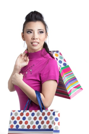 Young trendy girl holding up shopping bag Stock Photo - 20901630