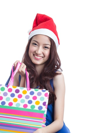 trendy girl: Young trendy girl holding up shopping bag Stock Photo