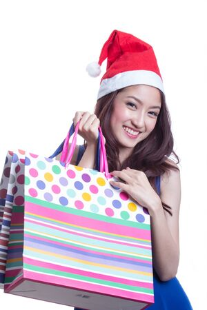 Young trendy girl holding up shopping bag photo