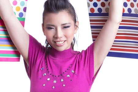 Young trendy girl holding up shopping bag Stock Photo - 20901649