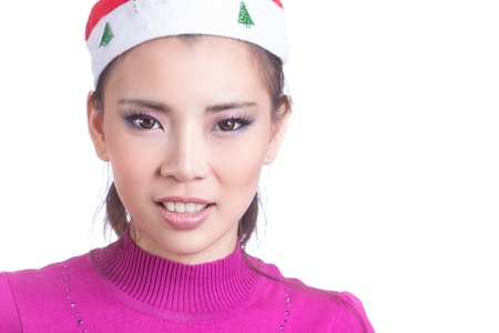 Young Happy Girl Smile with Christmas hat and red cloth Isolated on white background, model is a asian woman photo