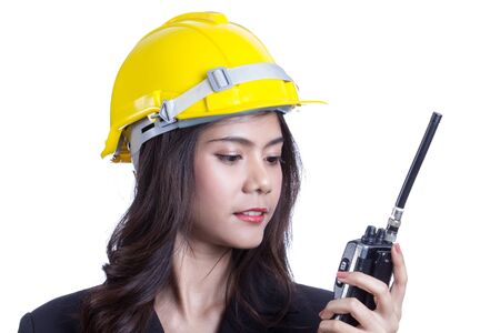 Beautiful Asian woman engineer holding a radio. photo