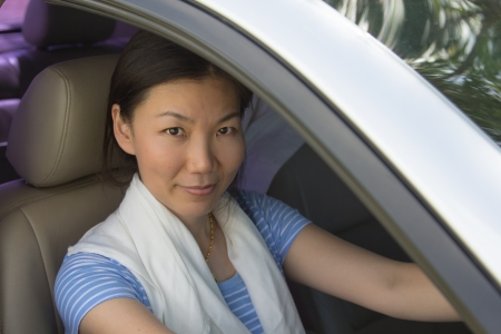 Asian women drive more happily. photo
