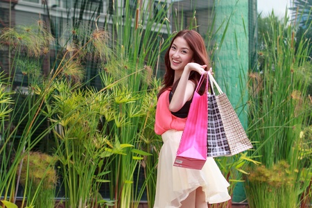 Asian women on holding a lot of shopping bag photo