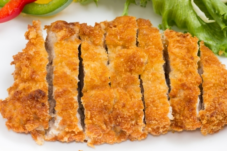 Japanese fried pork served with salad. Stock Photo