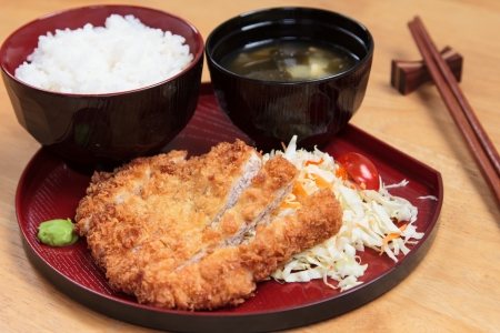 Fried breaded pork served with steamed rice and soup.